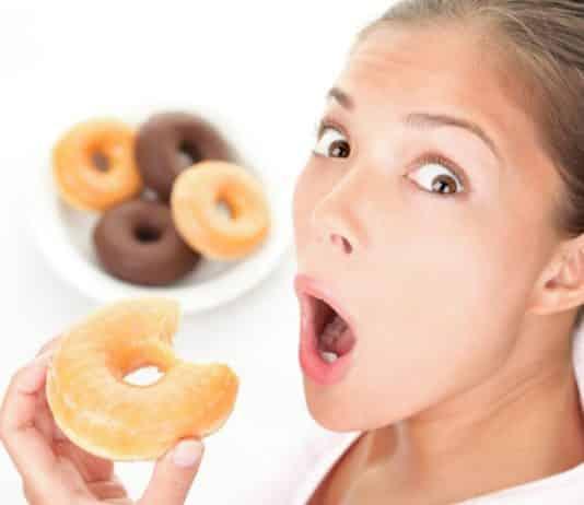 Funny woman eating junk food