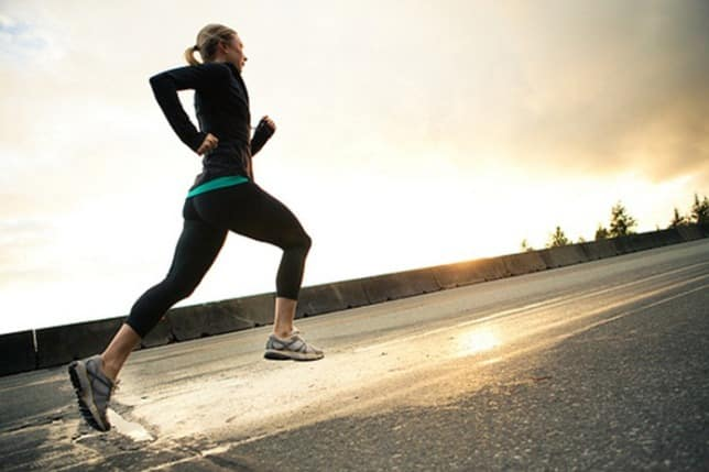 woman rain running