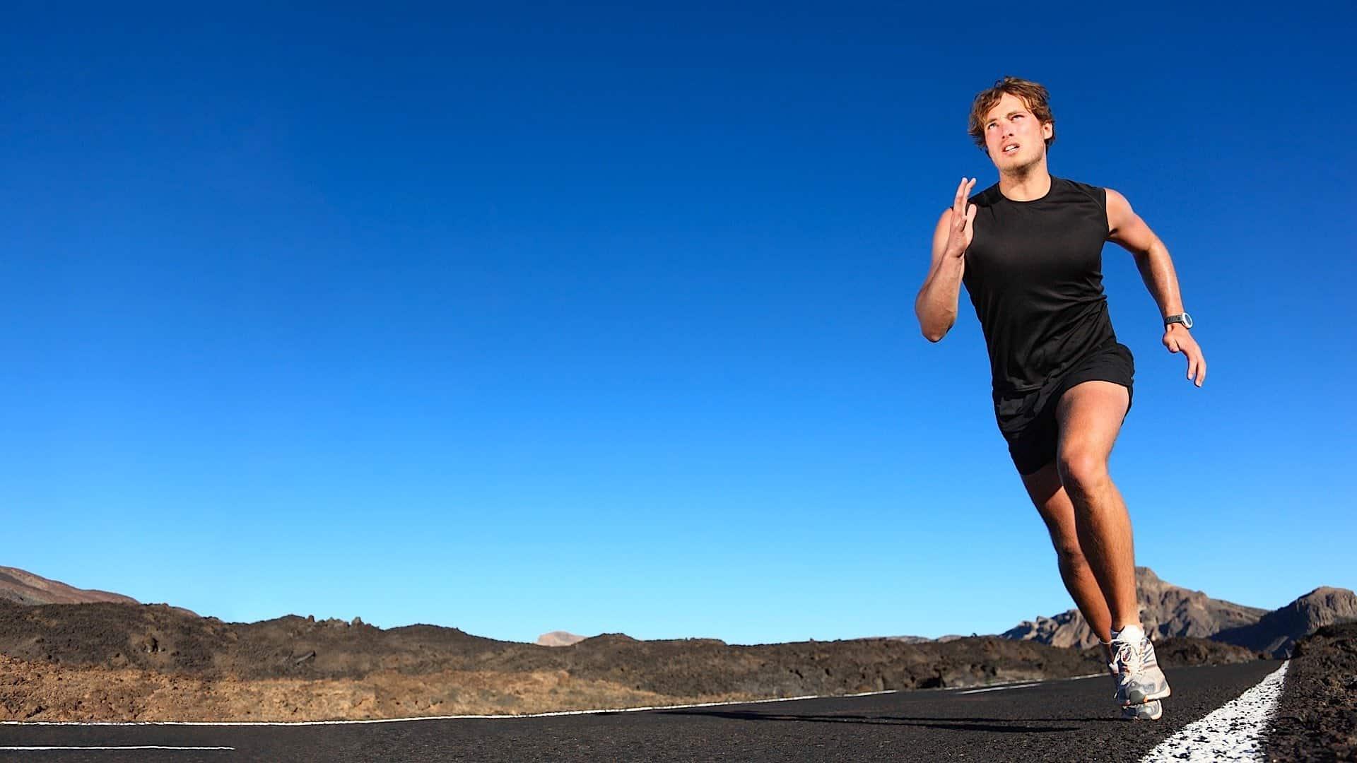 man running mountain road